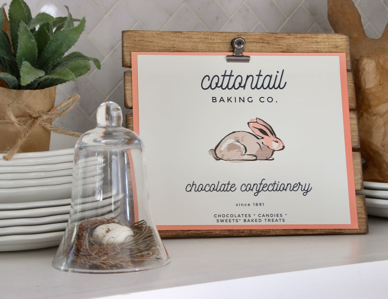 Cottontail Baking Company with Bunny logo on stained easel