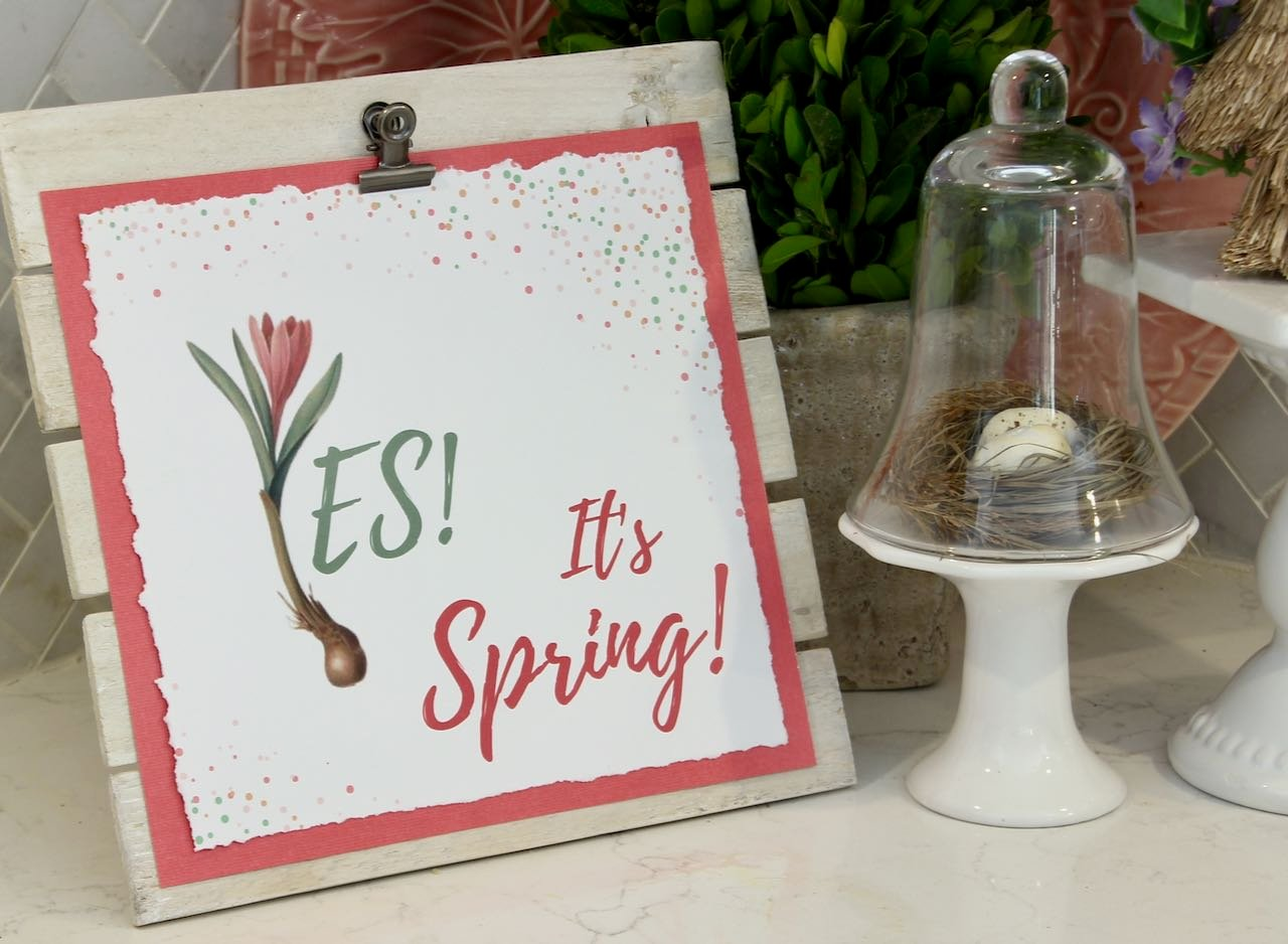 """""""Yes, It's Spring"""" graphic clipped on the white washed easel"""