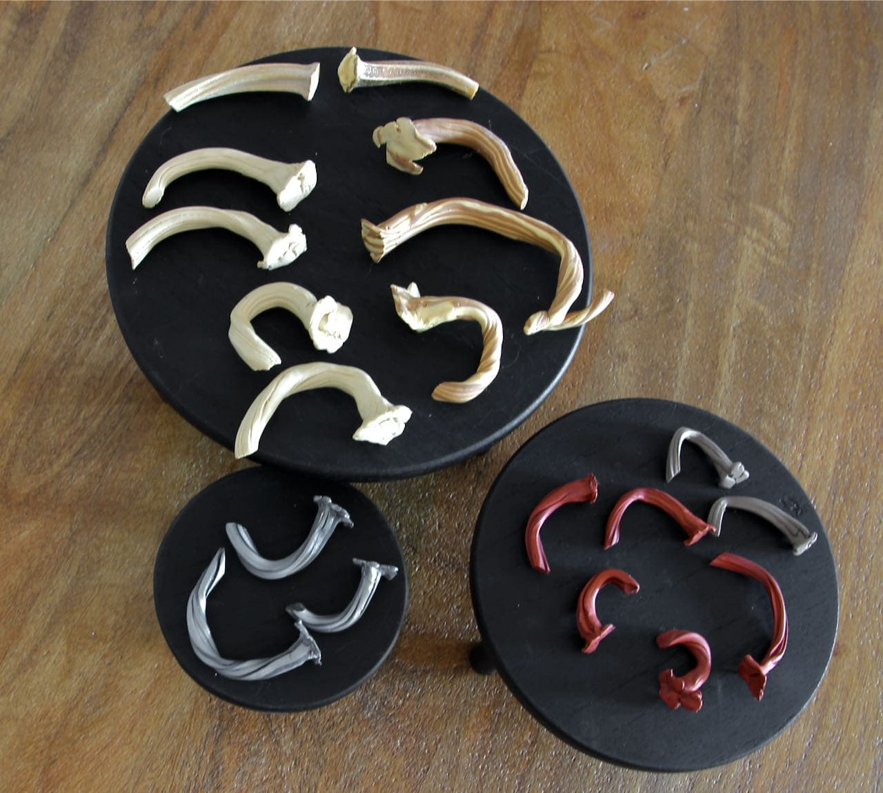 Polymer pumpkin stems arranged on three risers by color and size