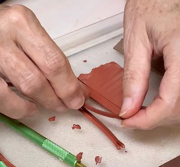 hands separating the slices and stacking them in a bundle
